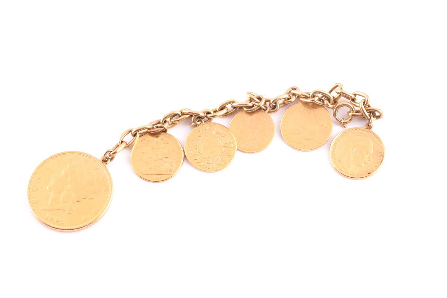 A yellow metal bracelet, suspended with six various fine gold coins, including an American 20 dollar