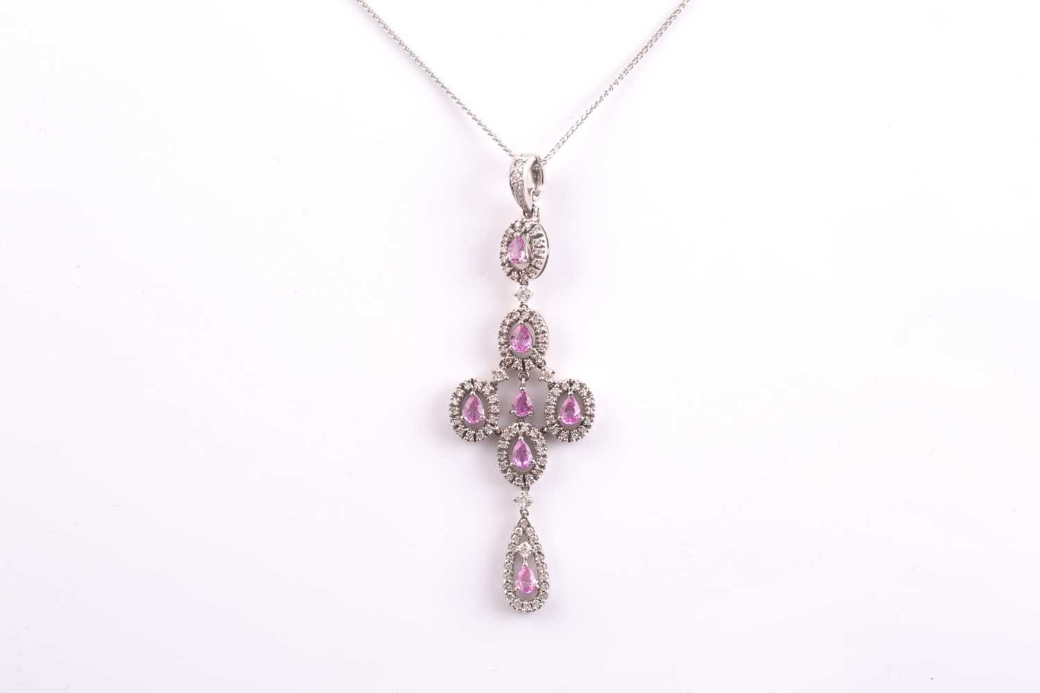 An 18ct white gold, diamond, and pink sapphire quatrefoil drop pendant necklace, the cross design - Image 3 of 4
