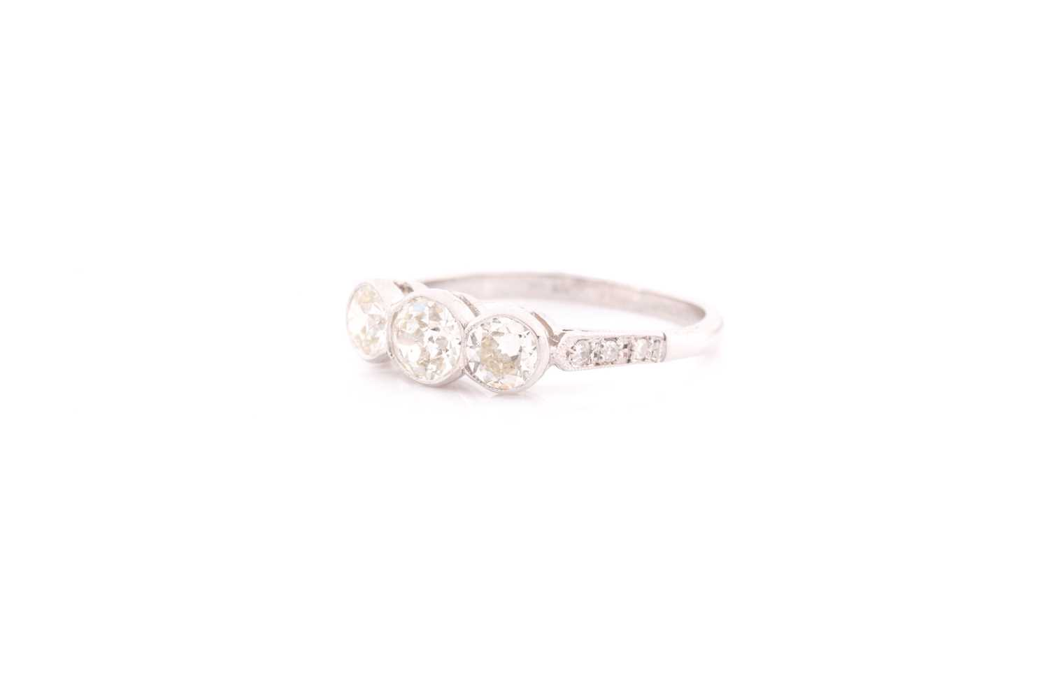 A platinum and diamond ring, collet-set with three old round-cut diamonds of approximately 1.35 - Image 3 of 4