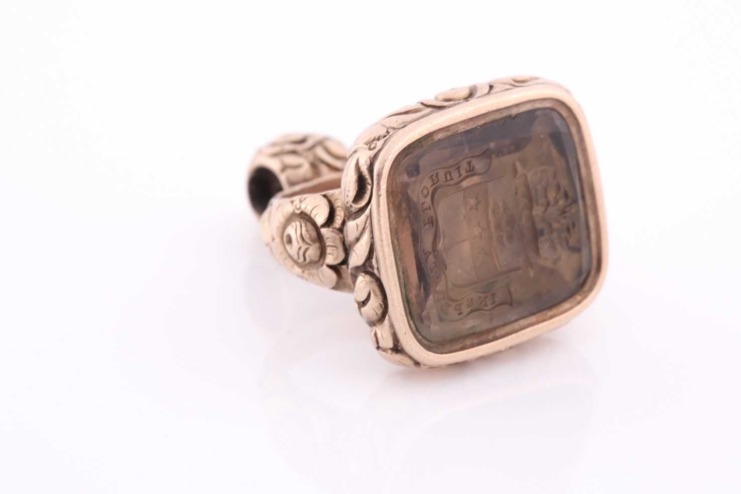 A yellow metal and citrine quartz fob pendant, the intaglio engraving bearing a motto and coat-of- - Image 4 of 4