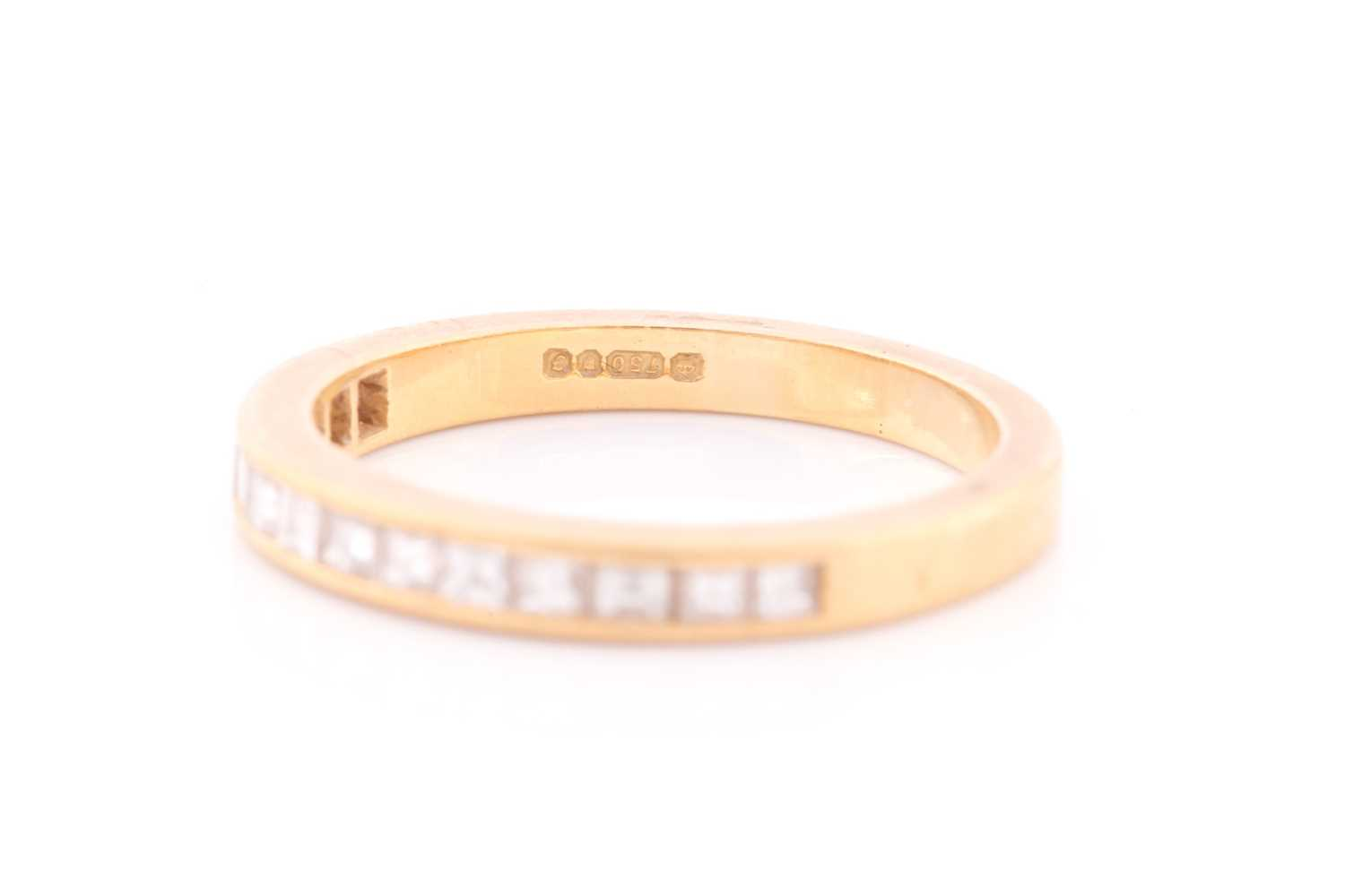 An 18ct yellow gold and diamond half-eternity ring the band calibre set with fourteen princess cut - Image 2 of 4