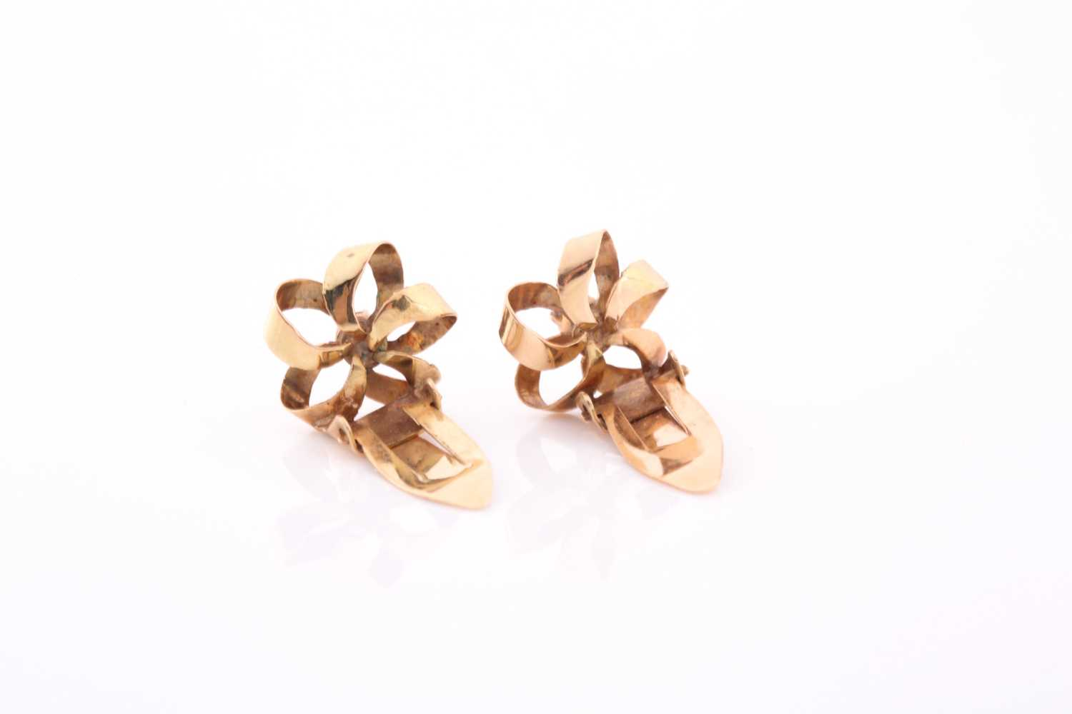 A pair of yellow metal ribbon-twist earrings, each centred with a small white stone, marked 585, - Image 3 of 3