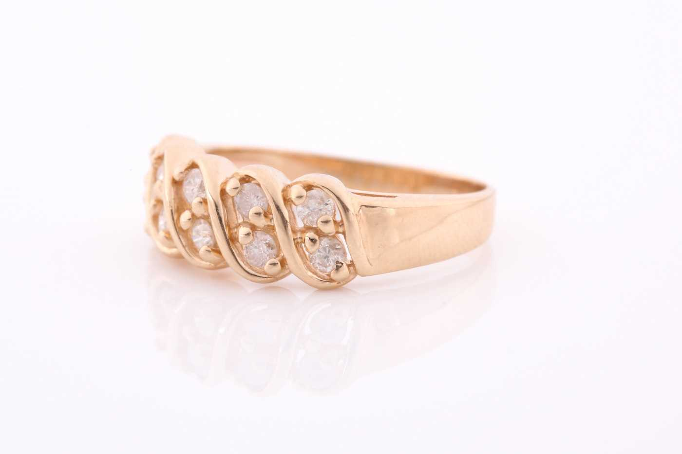 A yellow metal and diamond ring set with two rows of round-cut diamonds of approximately 0.50 carats - Image 3 of 4