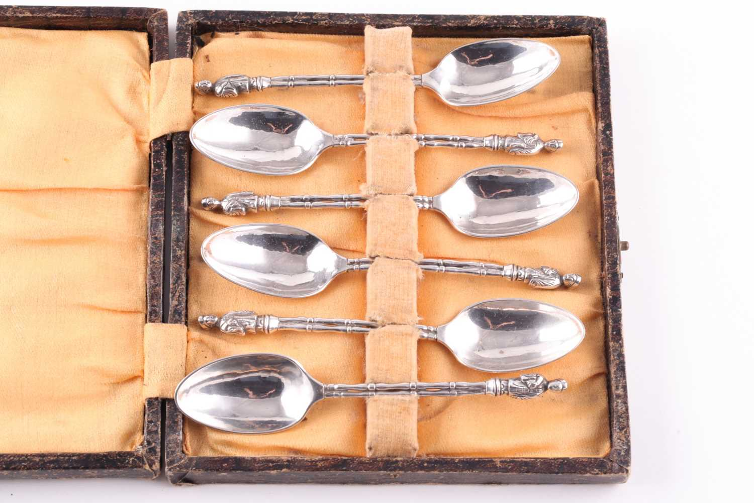 A set of six Chinese silver Apostle spoons, each terminal set with a Chinese robed figure, bamboo-