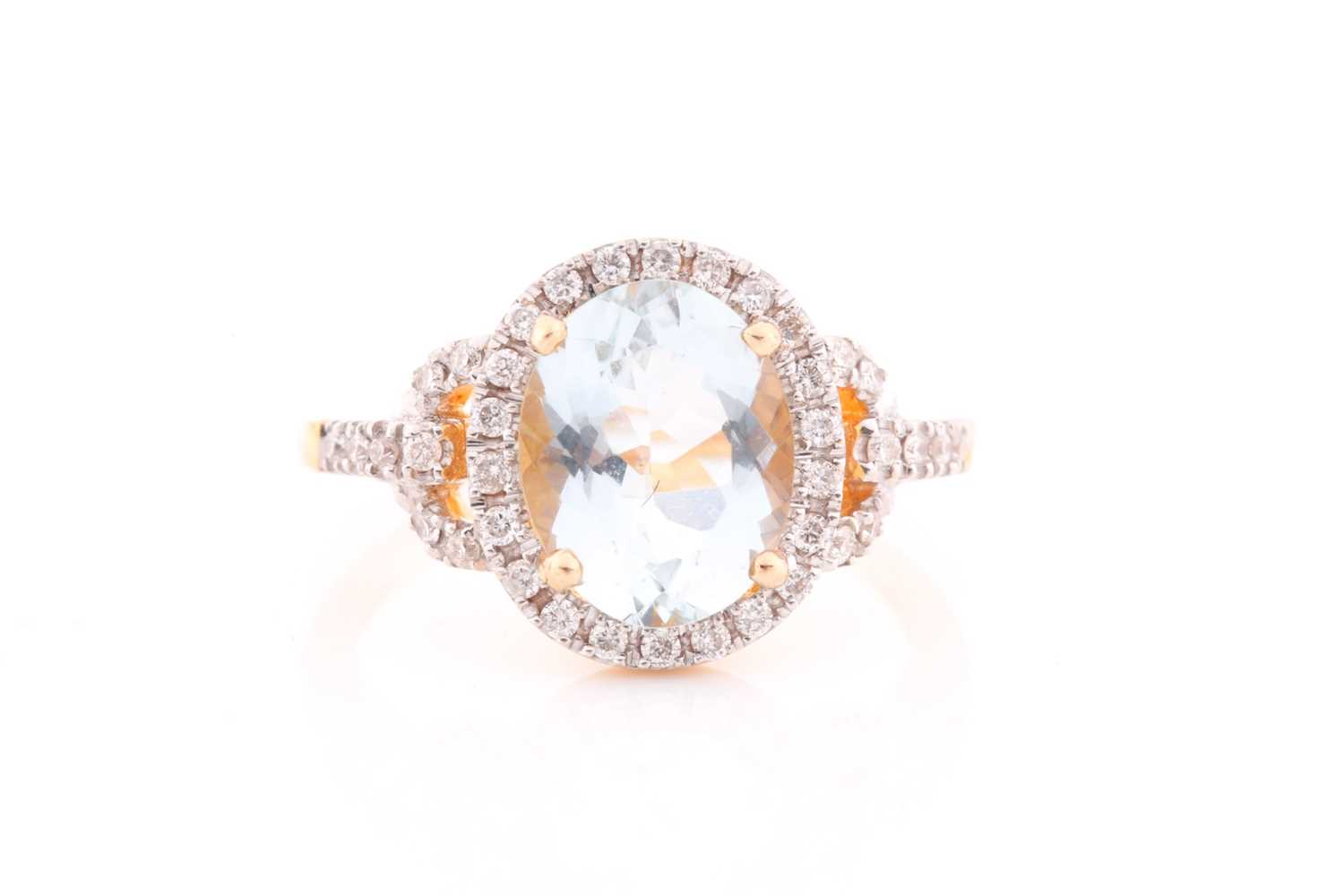 A diamond and aquamarine ring, set with a mixed oval-cut aquamarine of approximatley 2.30 carats,