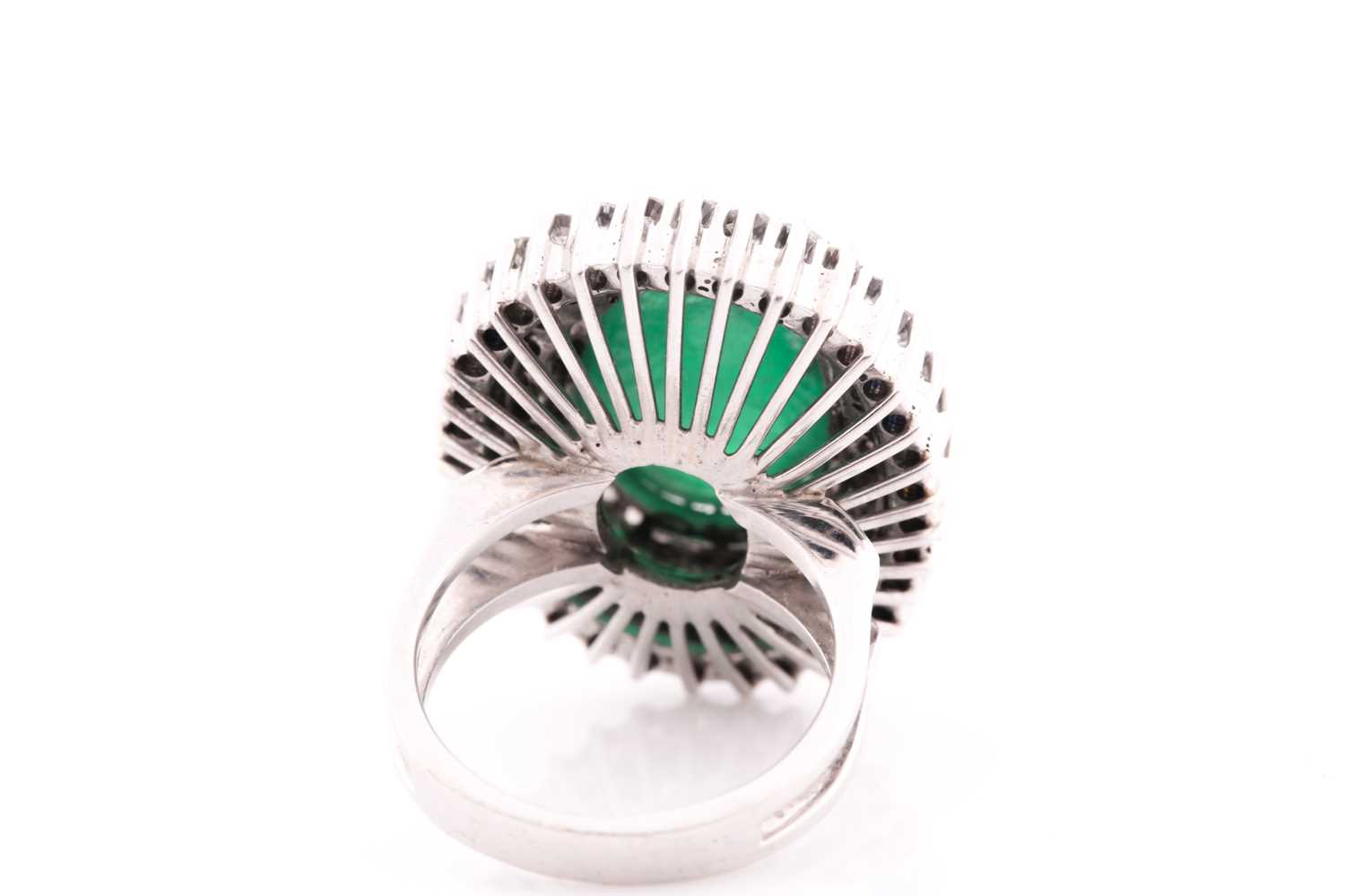 A diamond and emerald cocktail ring, circa 1960s, centred with an oval cabochon emerald, measuring - Image 6 of 6