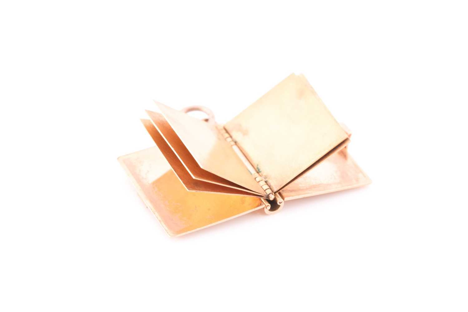 A yellow gold pendant in the form of a book, the hinged cover with quatrefoil decoration, opening to - Image 3 of 4