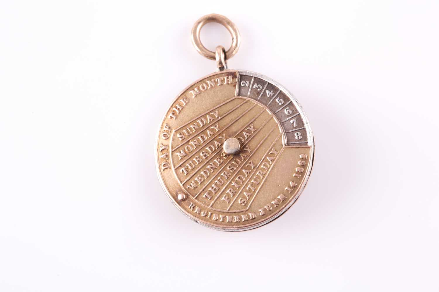 A 19th century yellow metal perpetual calendar pendant, with white metal central disk, featuring - Image 2 of 4