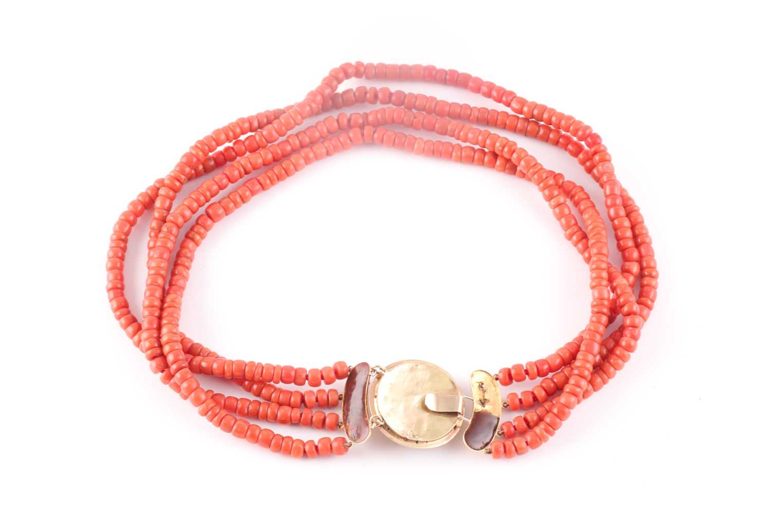 A four strand coral choker necklace, fastened with a Continental yellow metal clasp, the roundel - Image 4 of 4