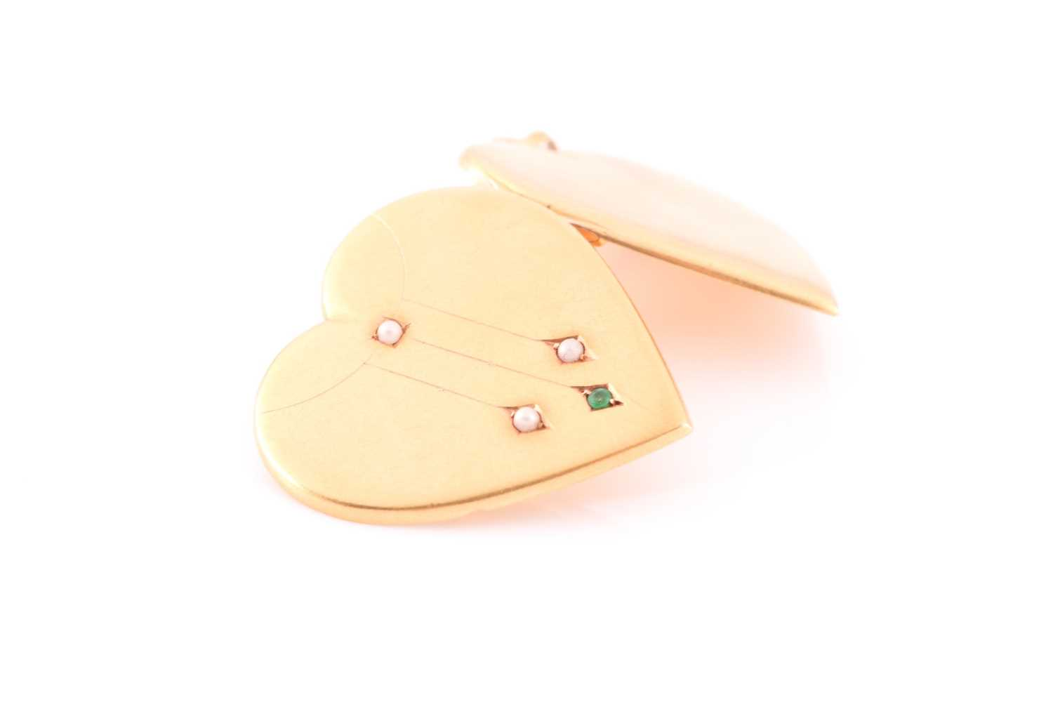An early 20th century yellow metal heart-shaped locket pendant, the hinged front inset with small - Image 4 of 5