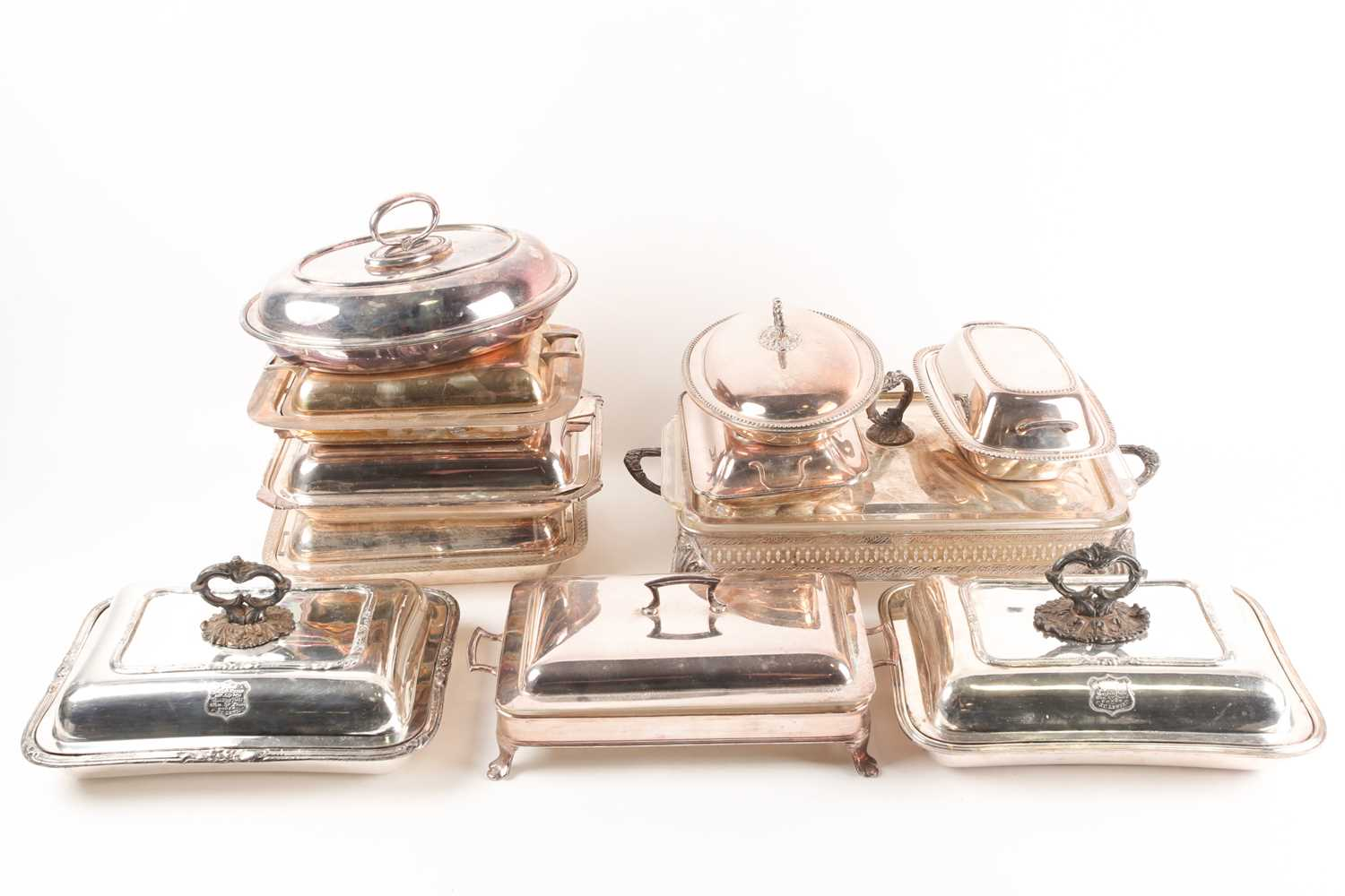 A pair of 19th century silver plated tureens and covers, the covers with shield shape cartouch