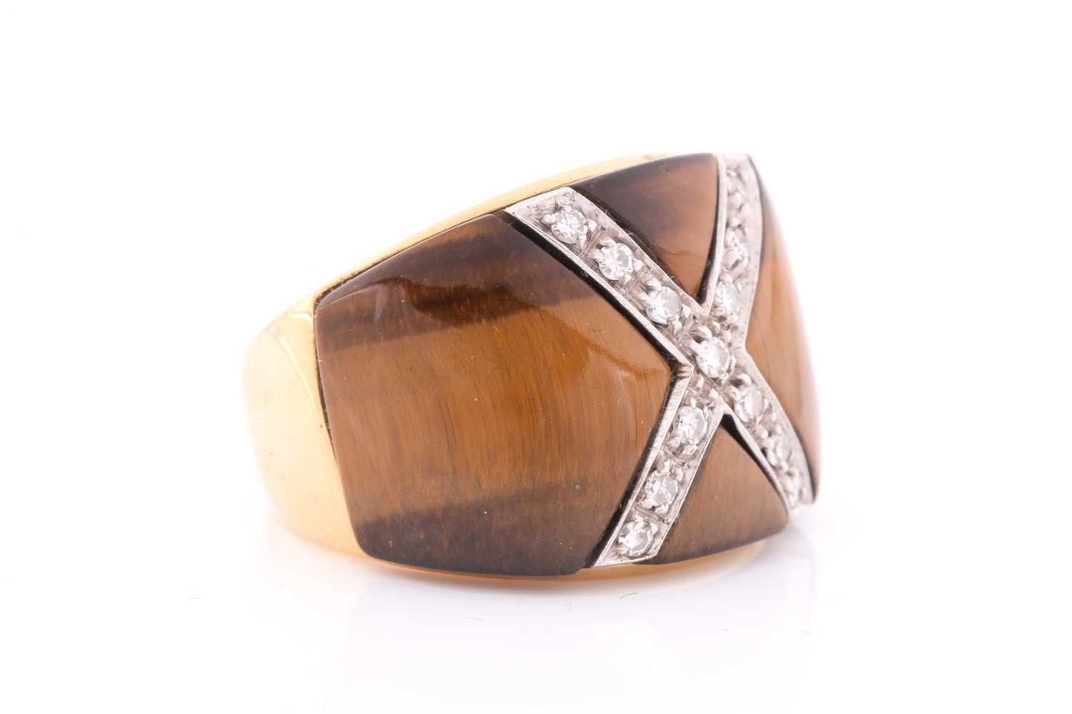 A yellow metal, diamond, and tigers eye cocktail ring, the wide band inset with a diamond-set cross, - Image 2 of 4