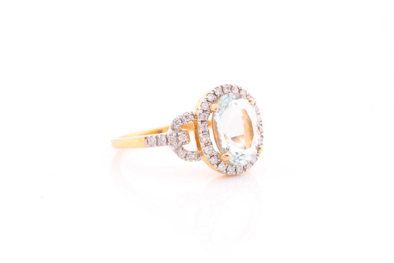 A diamond and aquamarine ring, set with a mixed oval-cut aquamarine of approximatley 2.30 carats, - Image 4 of 4