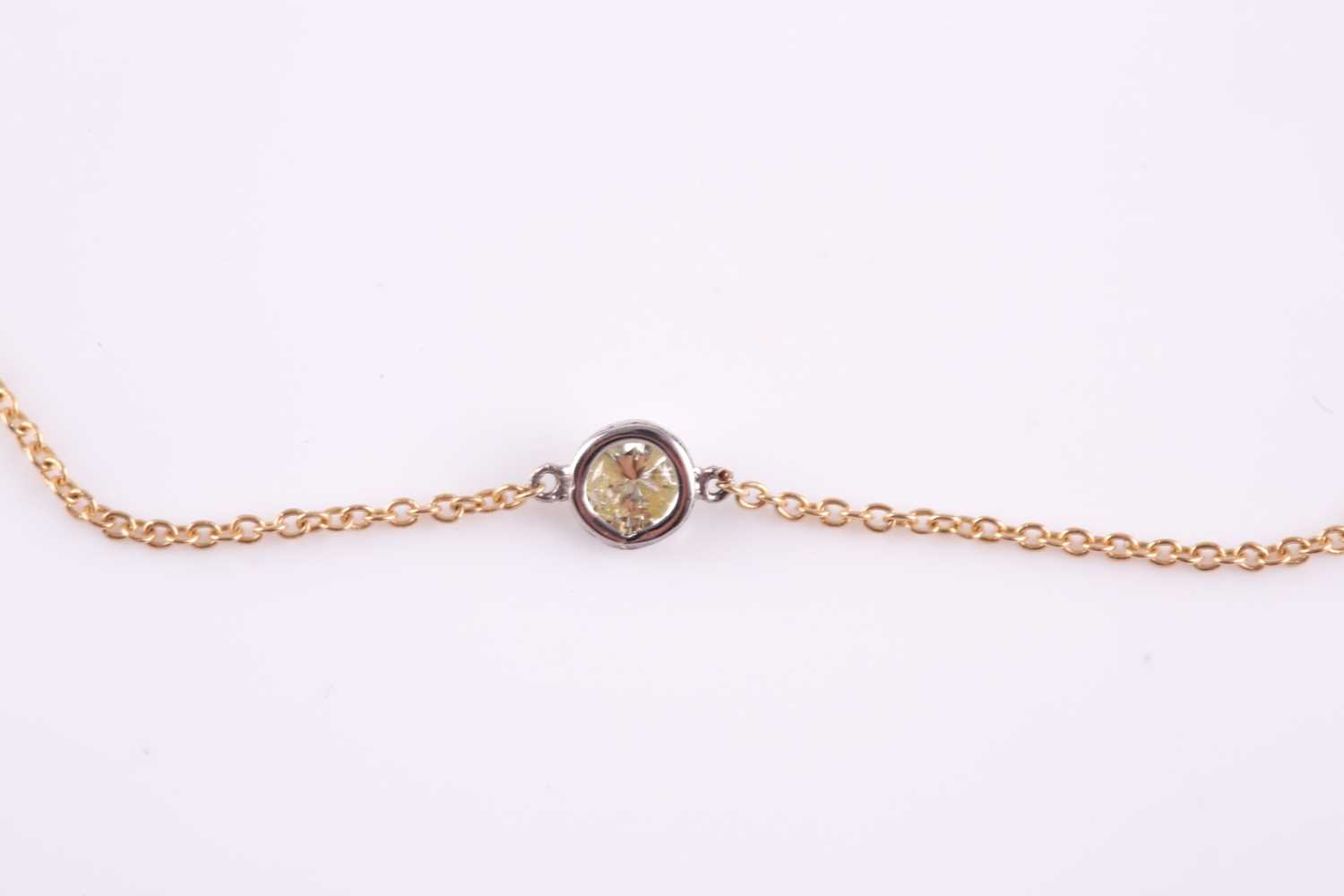 An 18ct yellow gold and diamond necklace, the chain set with a collet-mounted round brilliant-cut - Image 3 of 3