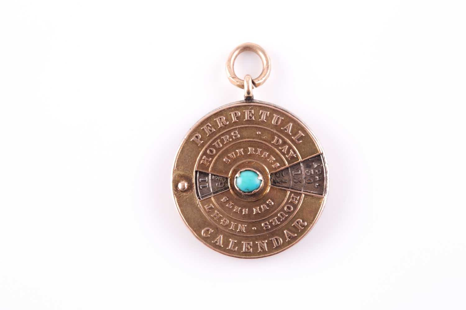 A 19th century yellow metal perpetual calendar pendant, with white metal central disk, featuring
