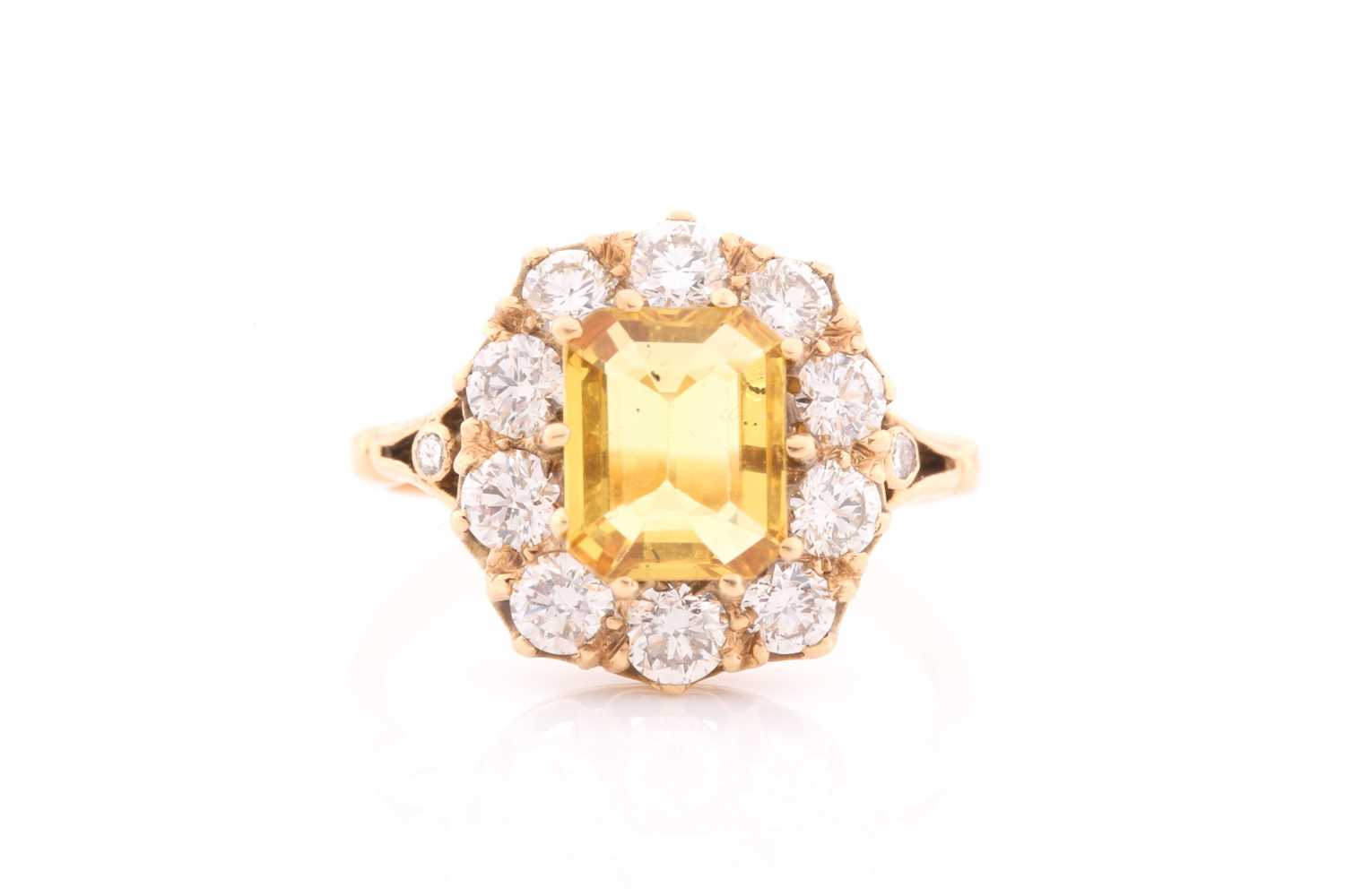 An 18ct yellow gold, diamond, and yellow sapphire dress ring, set with an emerald-cut sapphire of
