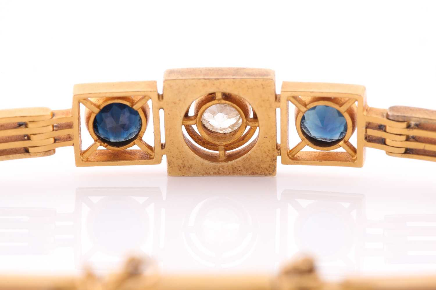 A yellow metal, diamond, and sapphire bracelet, set with a round-cut diamond of approximately 0.33 - Image 4 of 5