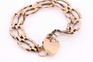 A 9ct yellow gold gate-link bracelet, approximately 17 cm long, fastened with a safety chain and a