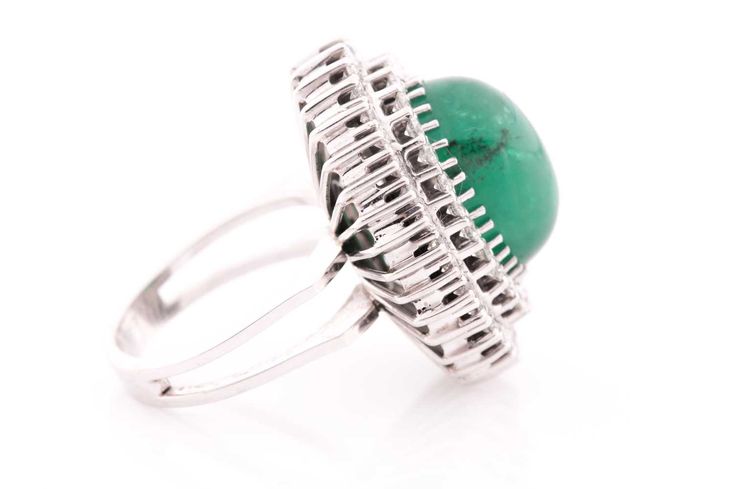 A diamond and emerald cocktail ring, circa 1960s, centred with an oval cabochon emerald, measuring - Image 5 of 6