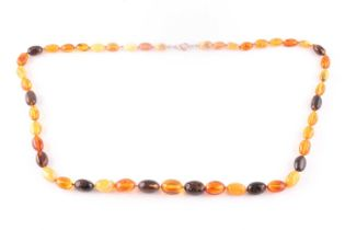 An amber bead necklace, comprising of butterscotch and dark and light amber beads, largest