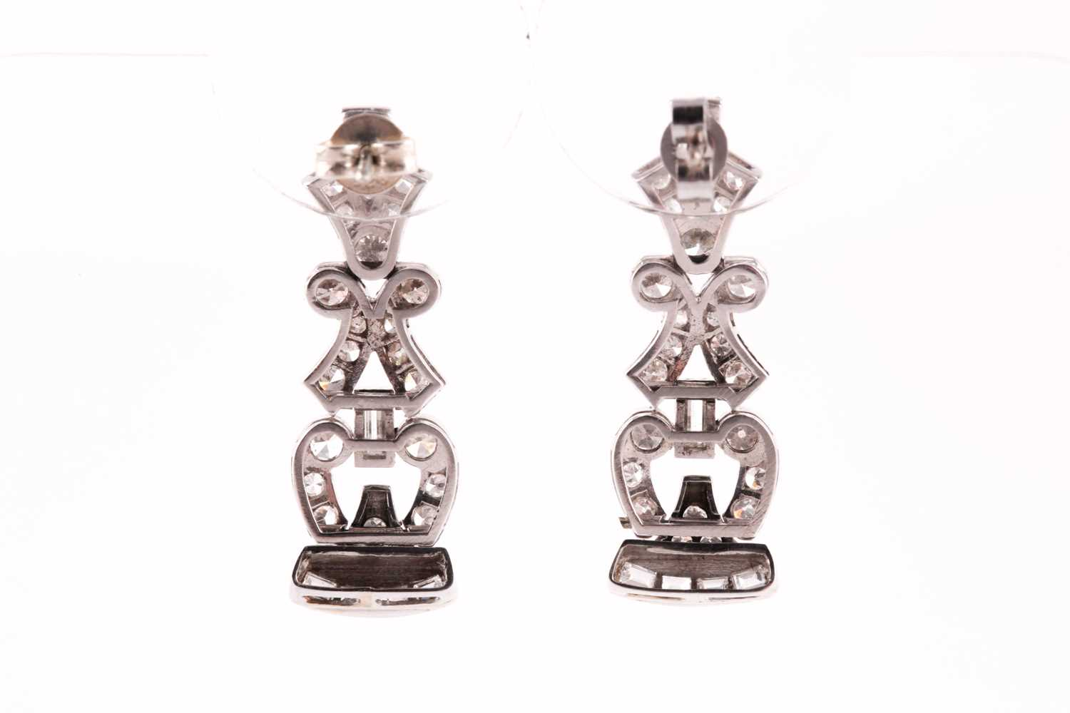A pair of platinum and diamond articulated drop earrings, set with eight-cut diamonds of - Image 2 of 2