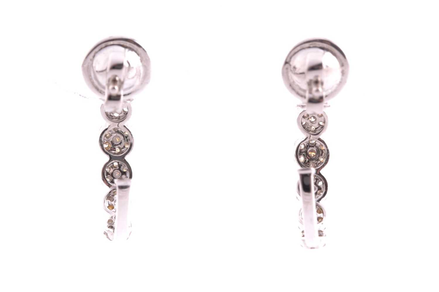 A pair of 18ct white gold and diamond earrings, each set with seven graduated floral clusters of - Image 3 of 3