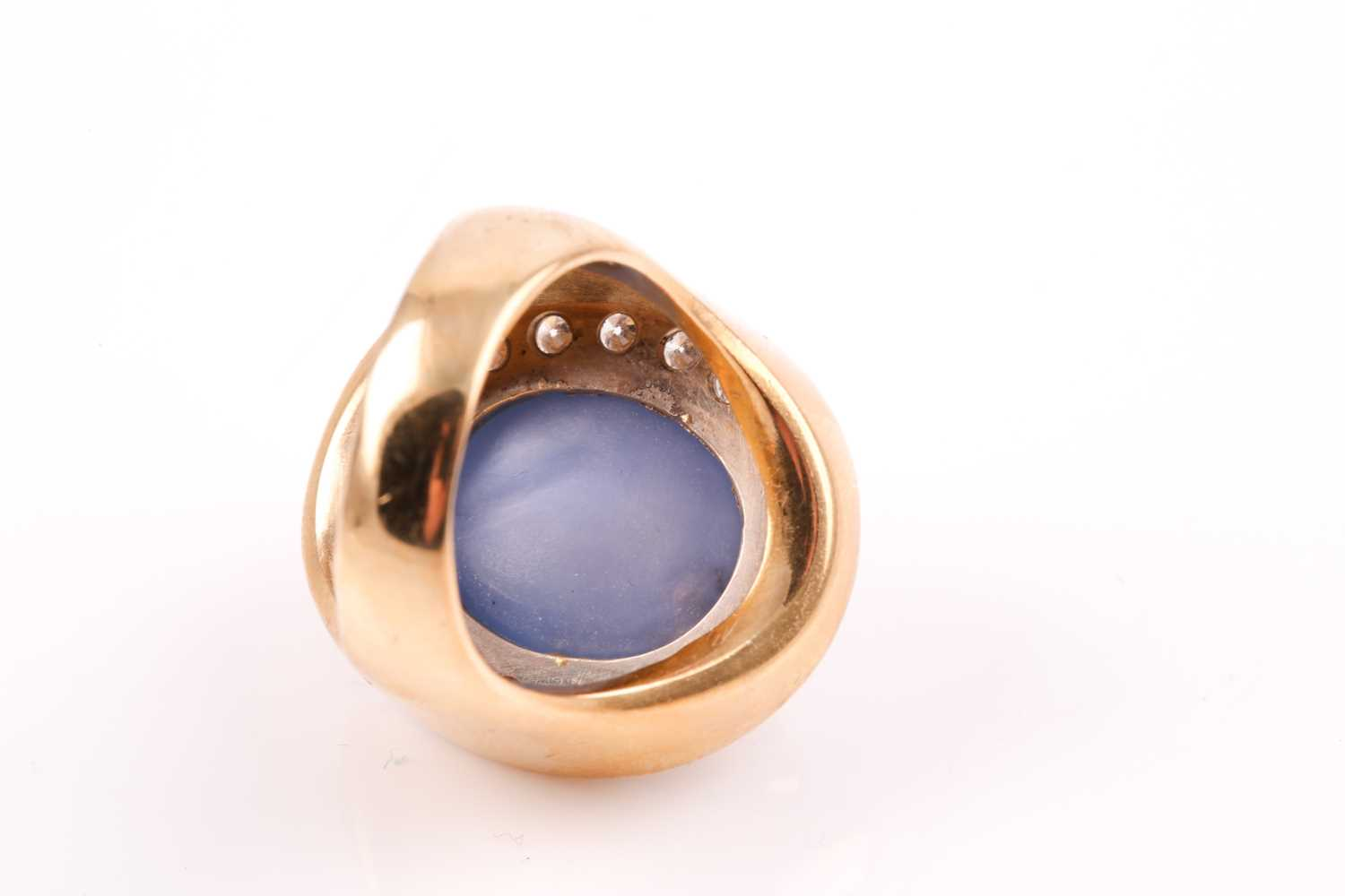 An 18ct yellow gold, diamond, and star sapphire cocktail ring, set with a domed cabochon sapphire, - Image 4 of 9