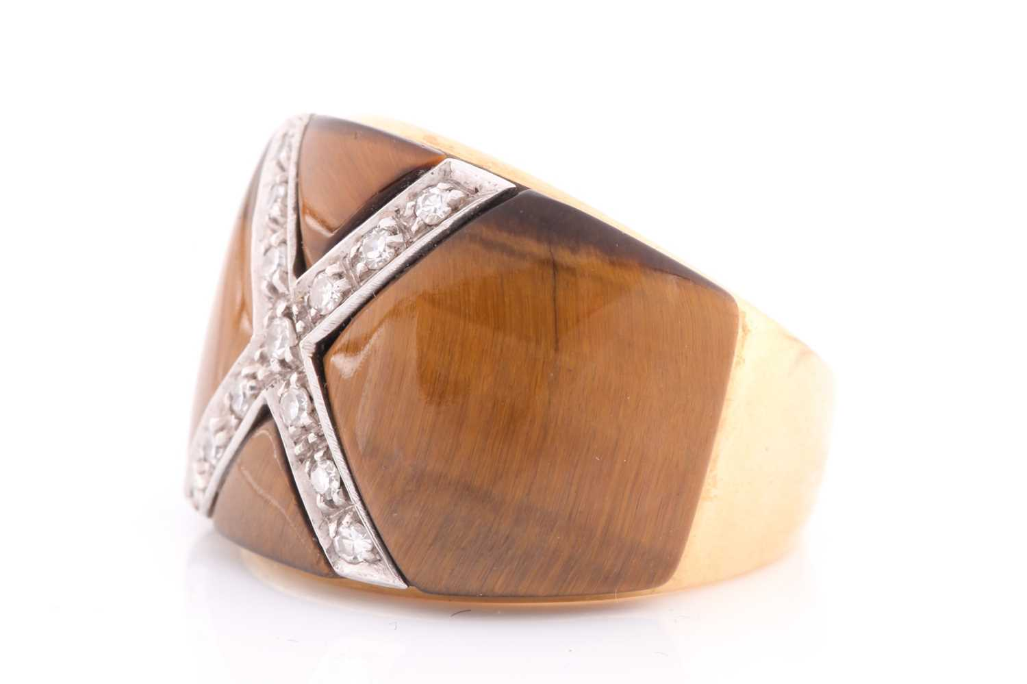 A yellow metal, diamond, and tigers eye cocktail ring, the wide band inset with a diamond-set cross, - Image 3 of 4