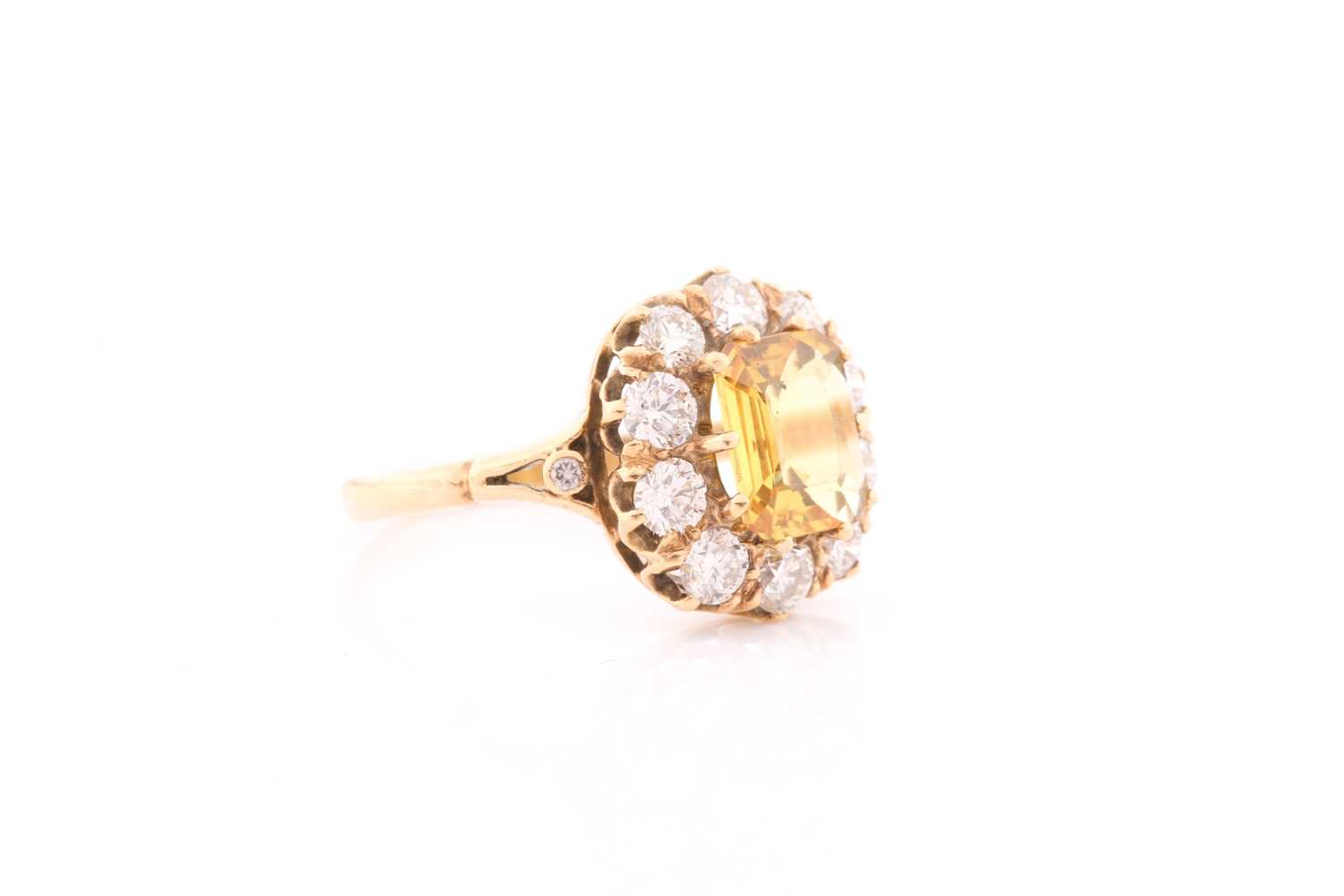 An 18ct yellow gold, diamond, and yellow sapphire dress ring, set with an emerald-cut sapphire of - Image 2 of 4