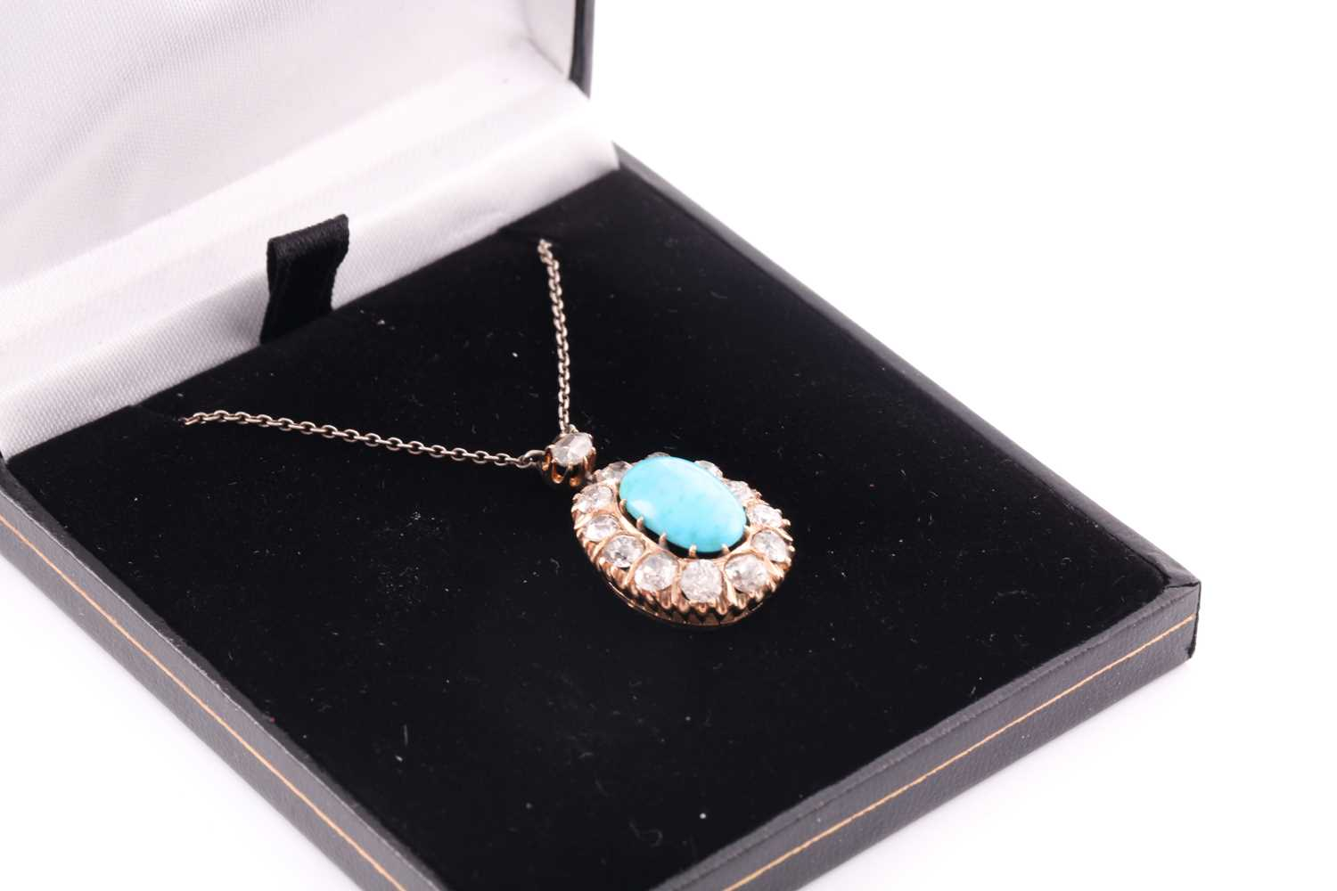 A diamond and turquoise cluster pendant, set with an oval turquoise plaque, surrounded with old- - Image 3 of 4