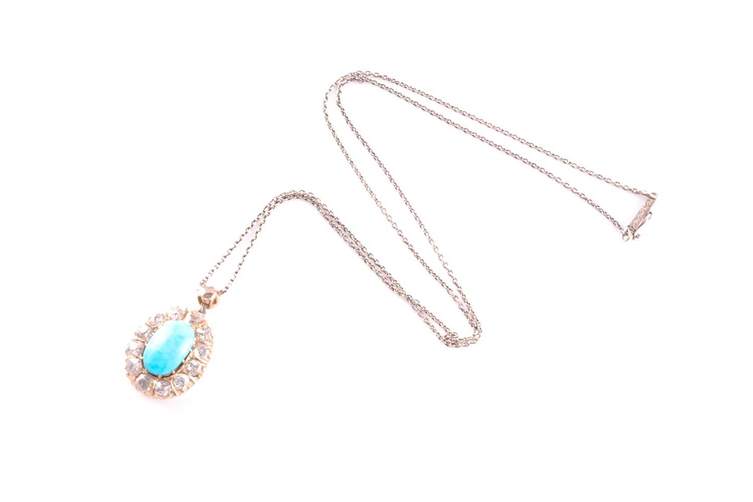 A diamond and turquoise cluster pendant, set with an oval turquoise plaque, surrounded with old- - Image 4 of 4