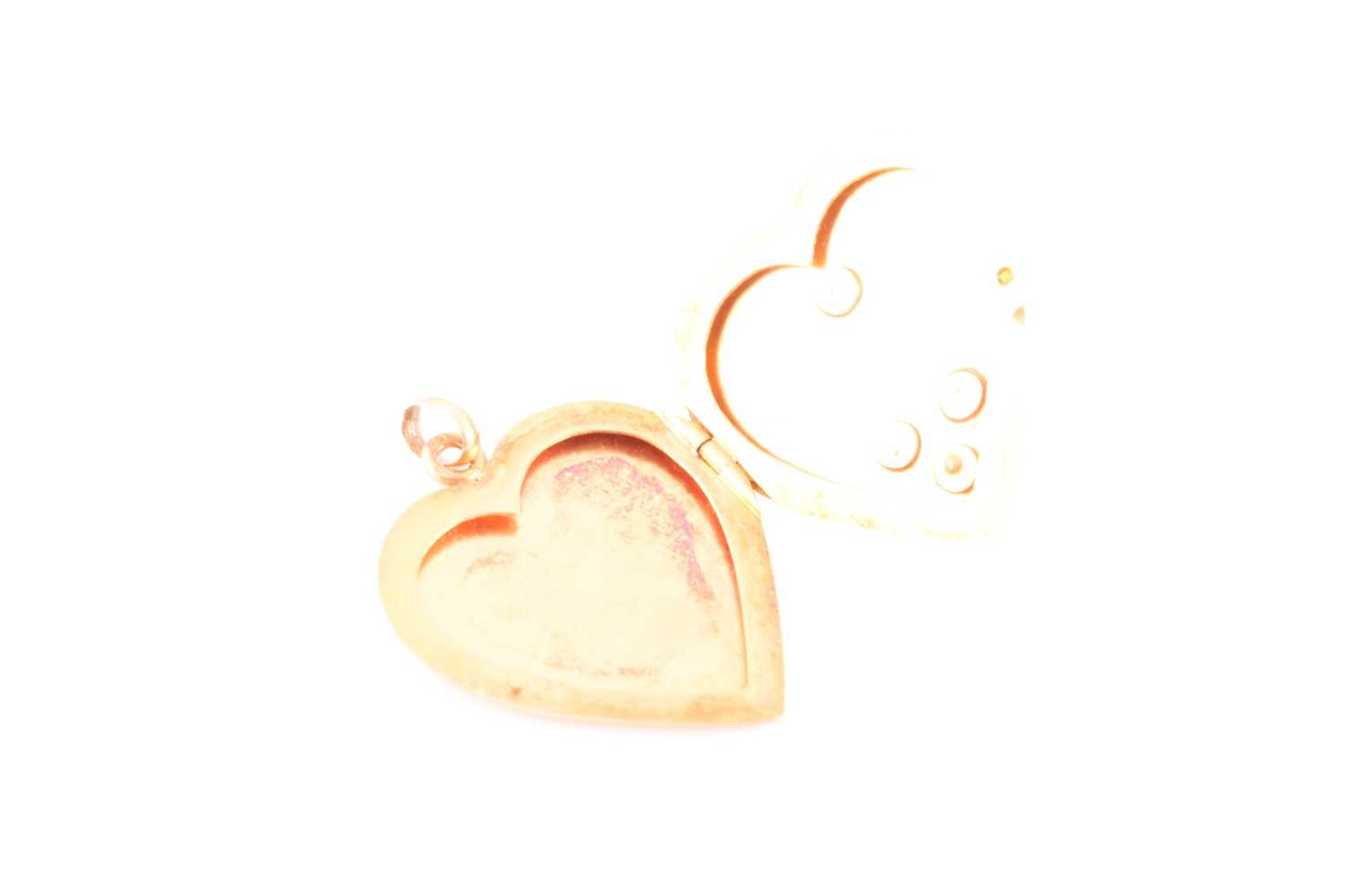 An early 20th century yellow metal heart-shaped locket pendant, the hinged front inset with small - Image 5 of 5