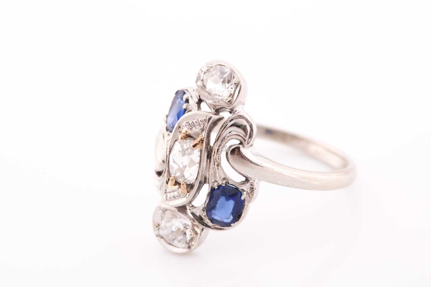 A diamond and sapphire ring, in the Art Nouveau style, the stylised mount inset with old Mine - Image 4 of 4
