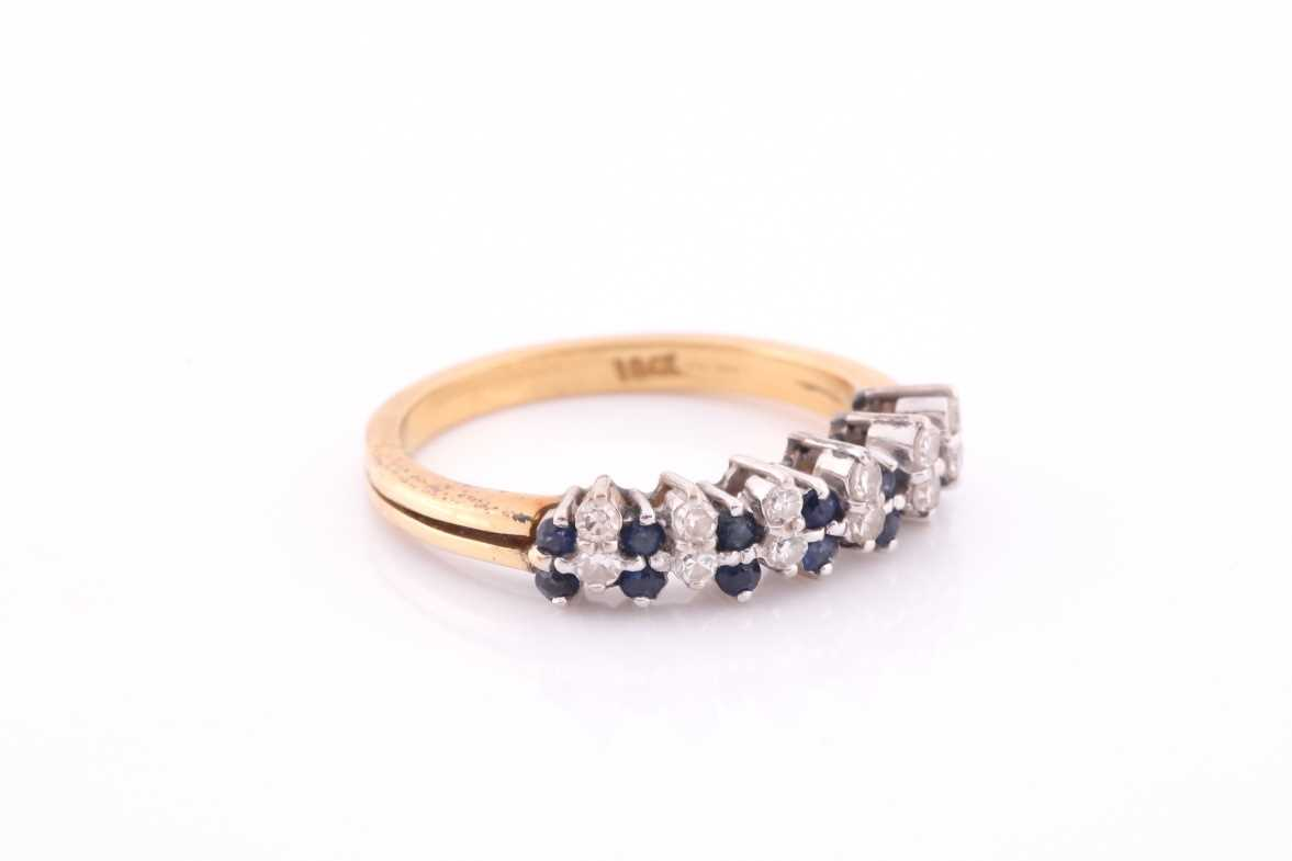 A sapphire and diamond half hoop ring; the round brilliant cut diamonds and circular cut sapphires - Image 2 of 4