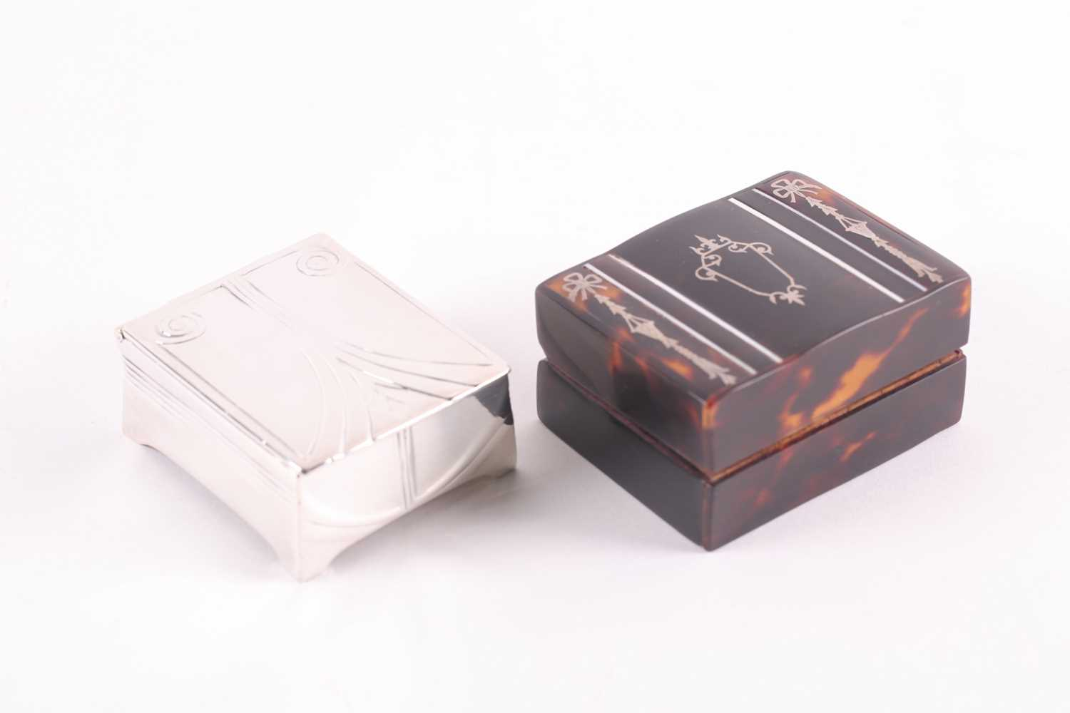 An Edwardian silver and tortoiseshell stamp box, rounded rectangular, the hinged cover with