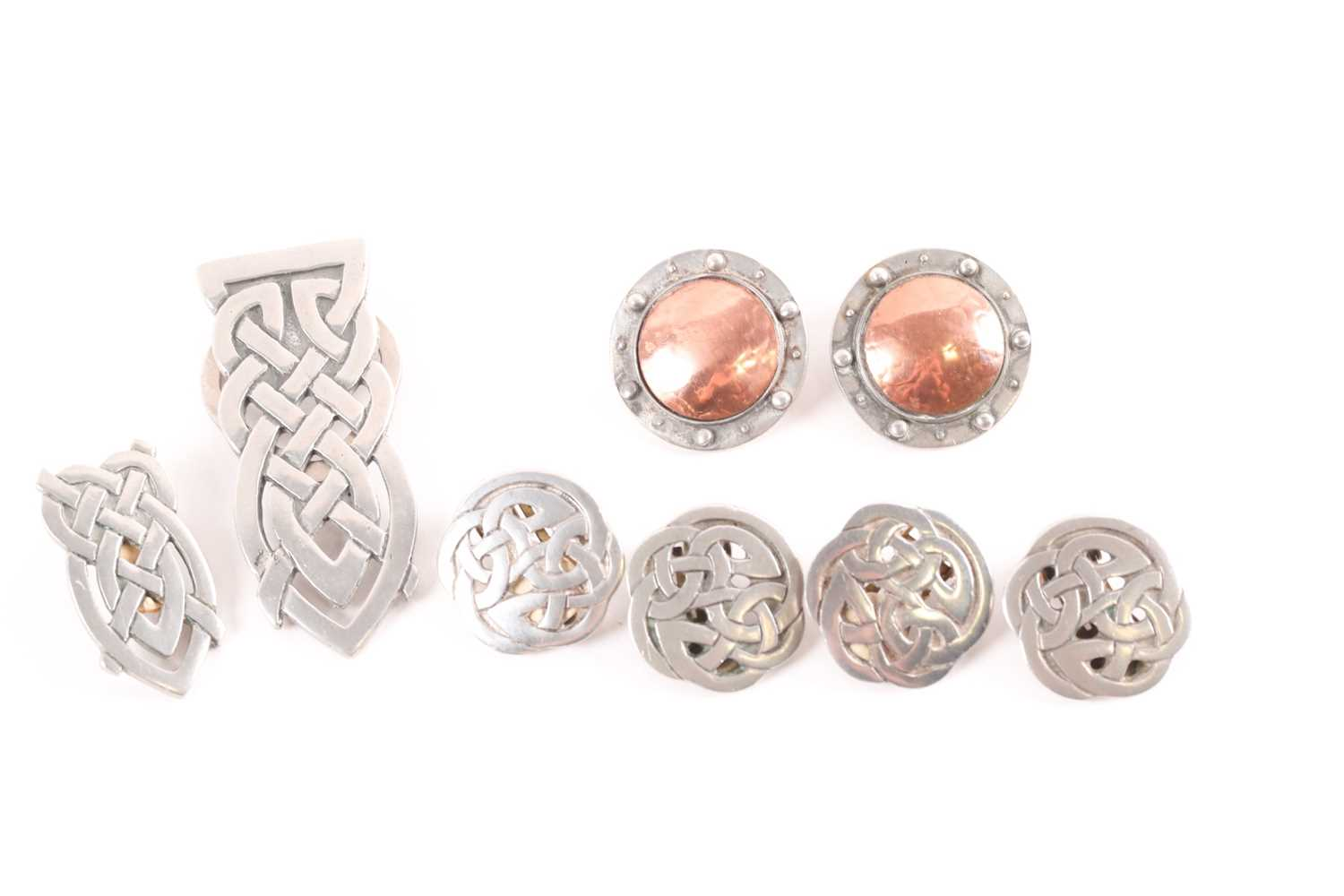 Three pairs of Liberty pewter clip earrings, of Arts and Crafts and Celtic design together with