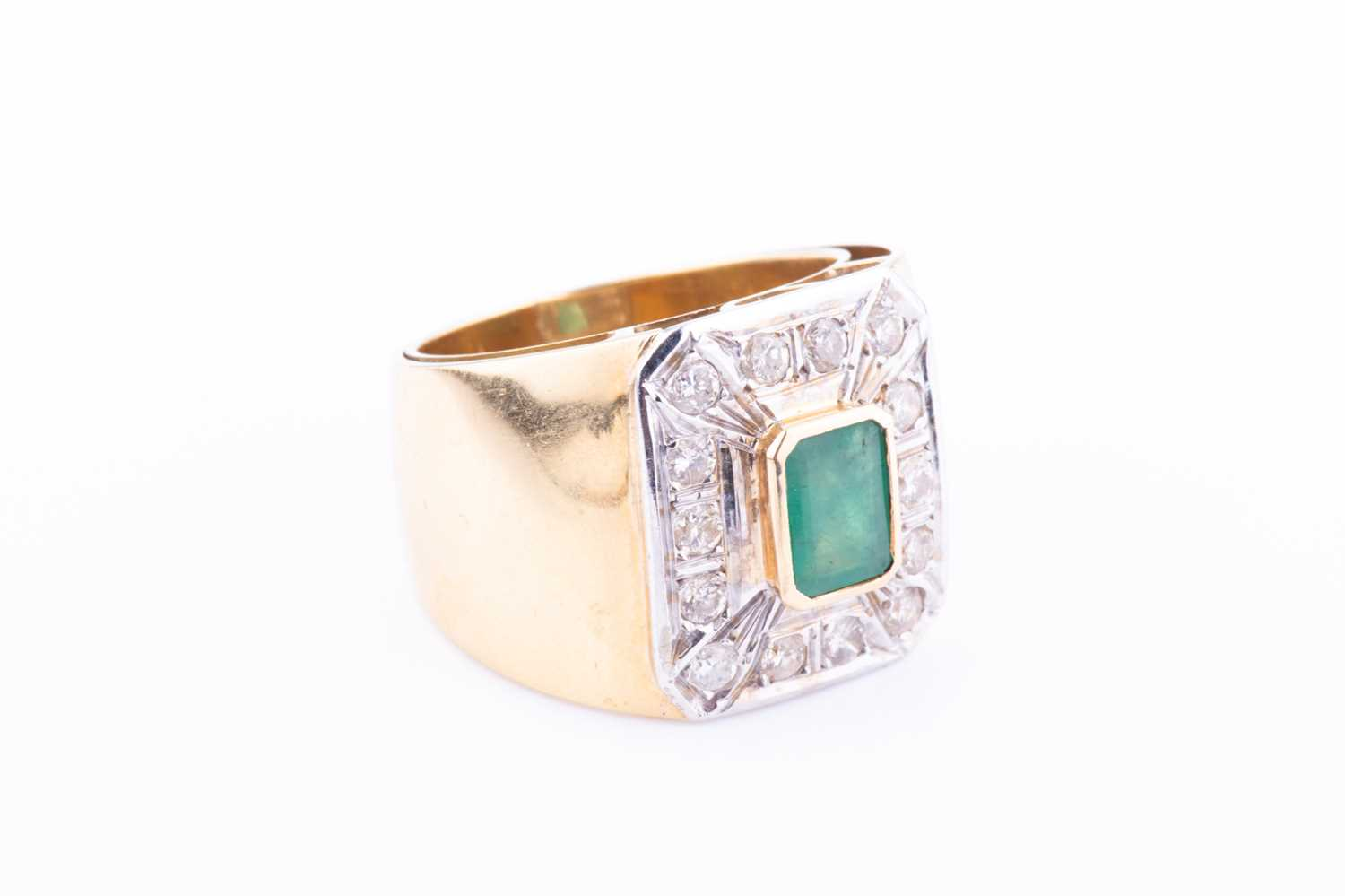 A yellow metal, diamond and emerald ring, centred with a bezel-set emerald, within a chamfered - Image 3 of 3