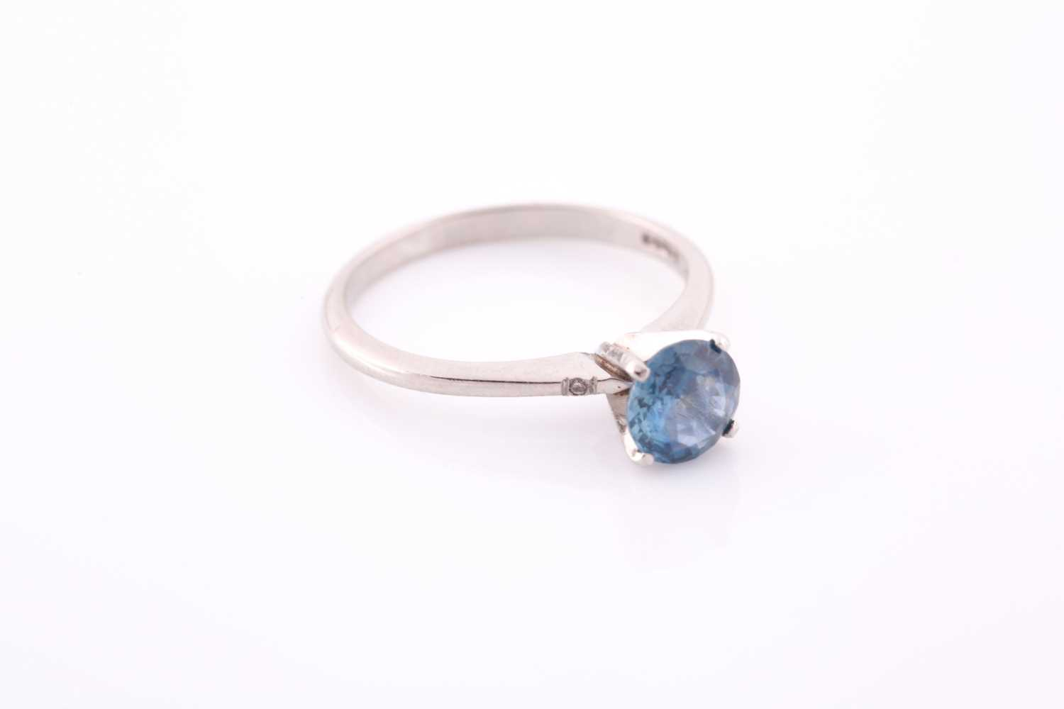 A platinum and solitaire sapphire ring, set with a mixed round-cut blue sapphire of approximately - Image 4 of 4