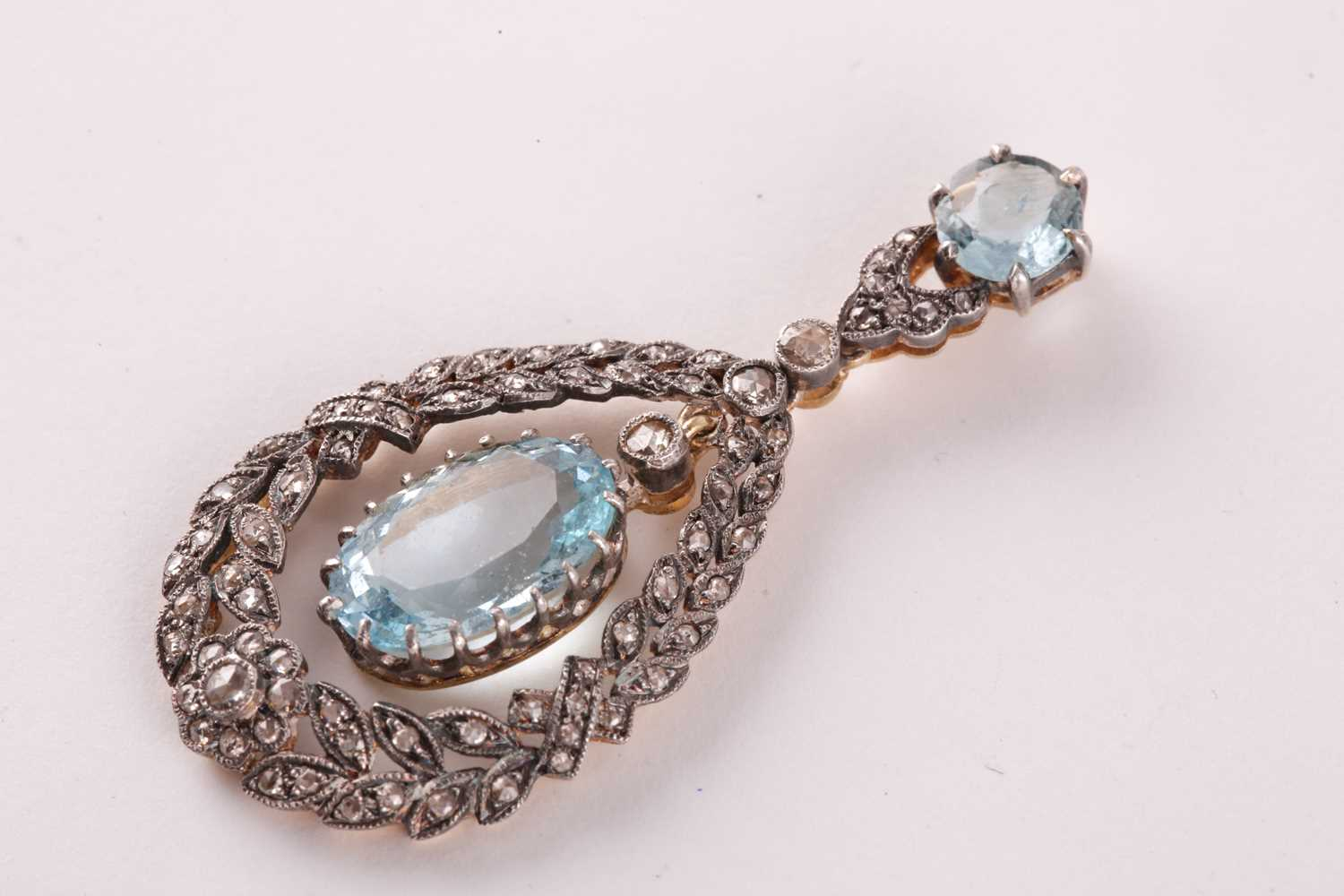 A diamond and aquamarine pendant, set with a claw-mounted mixed oval-cut aquamarine, within a - Image 3 of 3