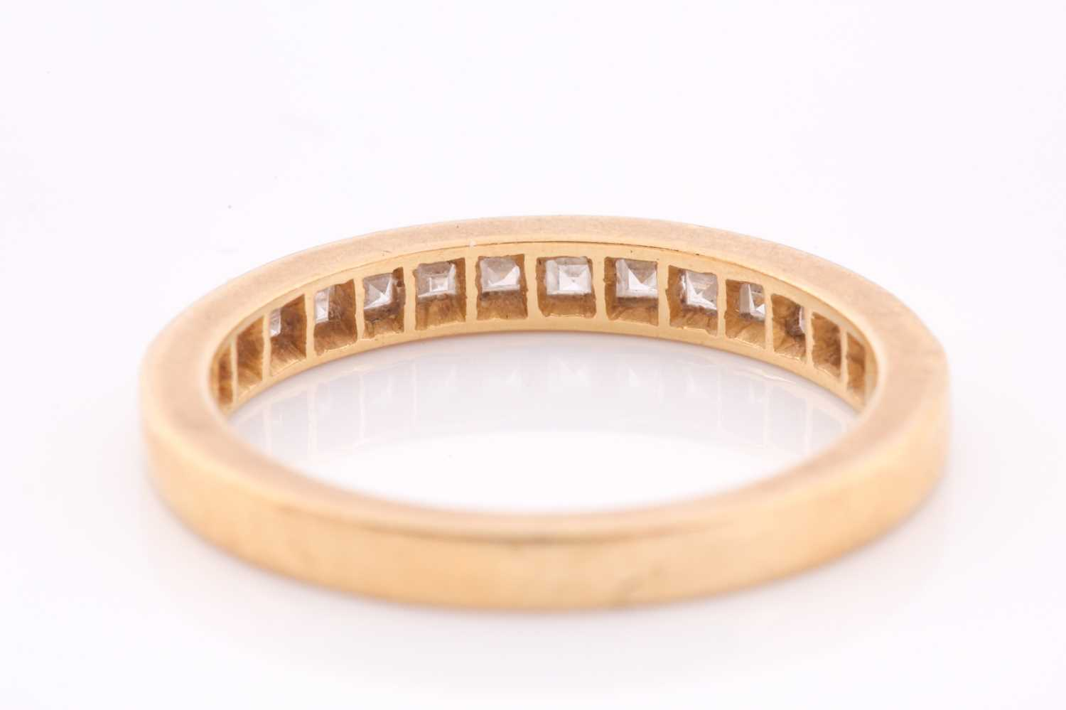 An 18ct yellow gold and diamond half-eternity ring the band calibre set with fourteen princess cut - Image 4 of 4