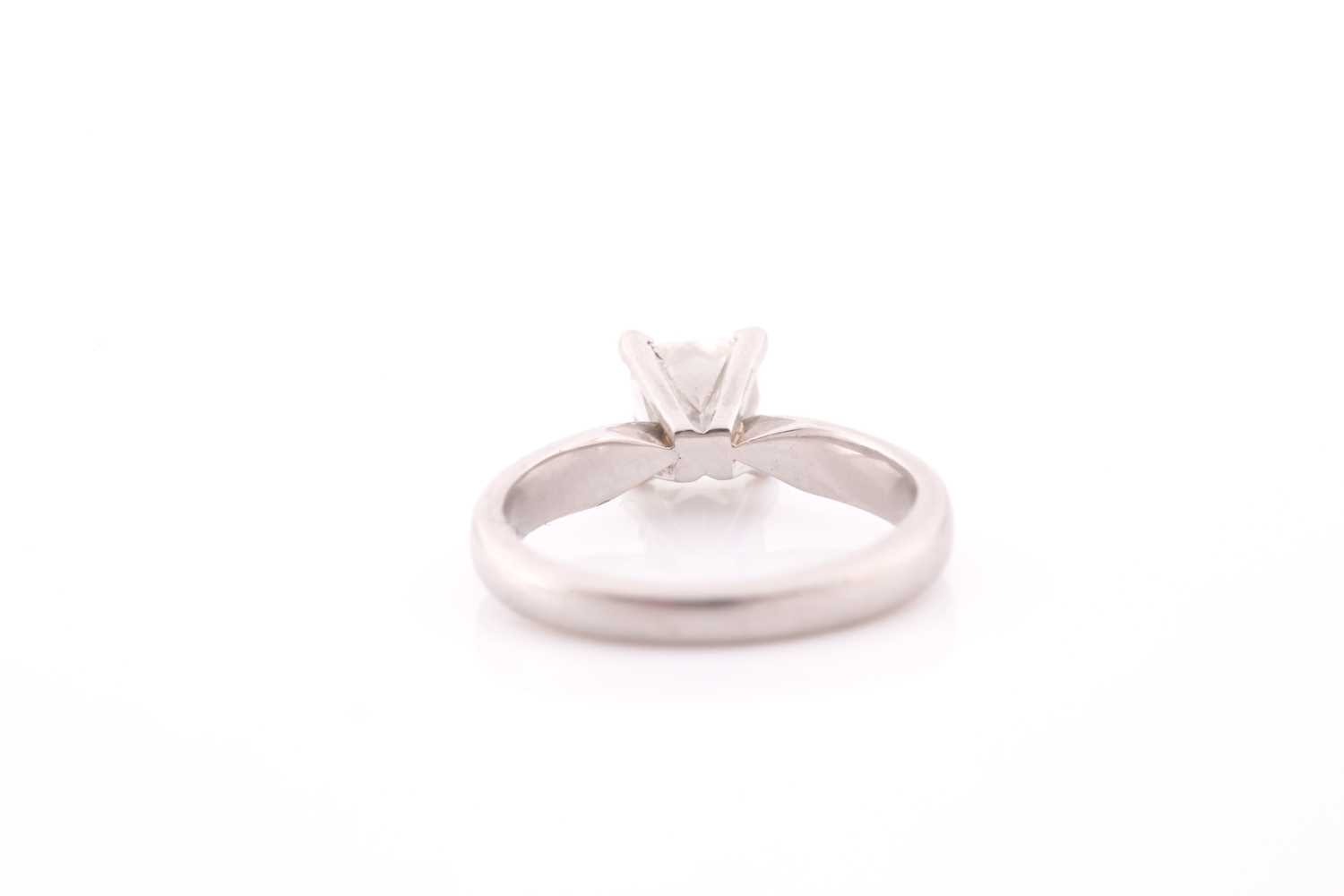 A platinum and diamond ring, set with a princess-cut diamond of approximately 0.80 carats, - Image 2 of 4