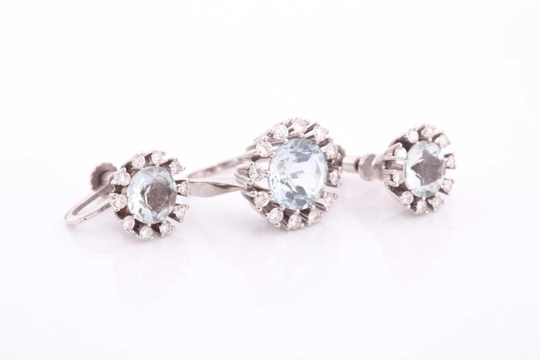 A white gold, diamond, and aquamarine ring, set with a round-cut aquamarine measuring - Image 2 of 4