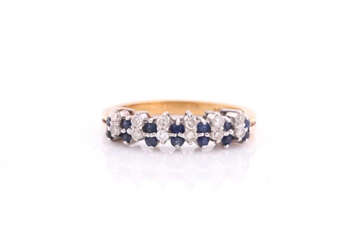 A sapphire and diamond half hoop ring; the round brilliant cut diamonds and circular cut sapphires