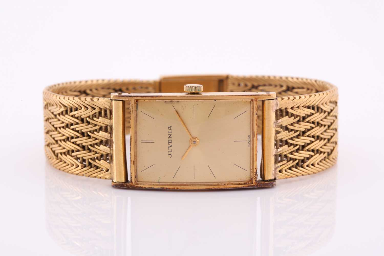 A yellow metal Juvenia watch, the rectangular gilt dial with baton markers, the case numbered