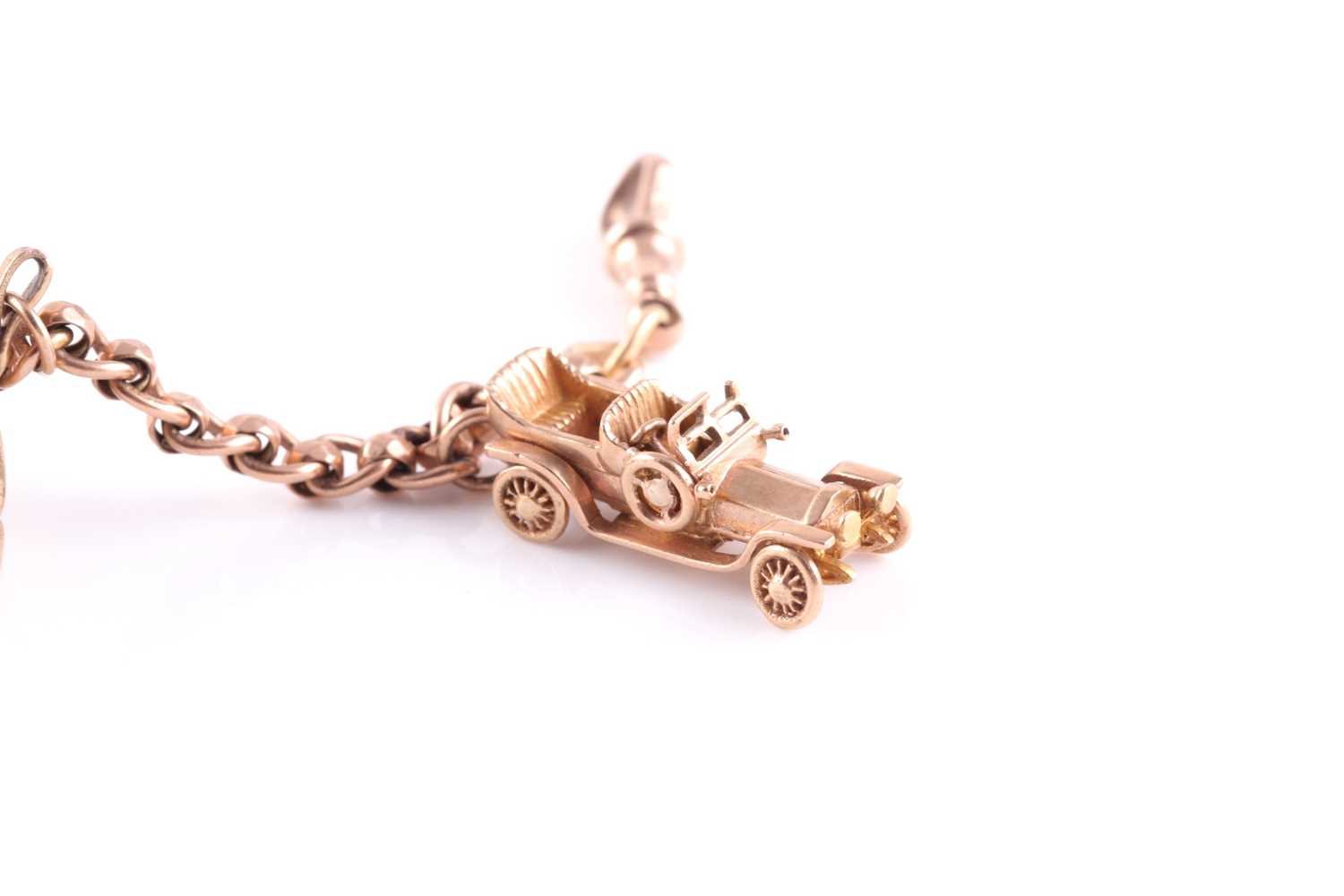 A yellow metal converted watch chain charm bracelet, suspended with yellow metal and silver gilt - Image 5 of 5