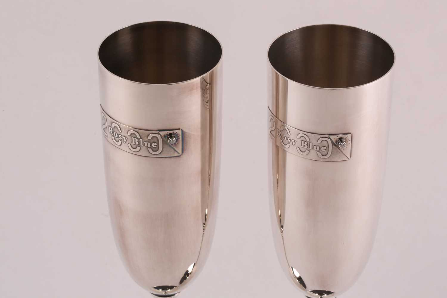 A pair of commemorative limited edition silver champagne flutes; with applied plaques reading ' - Image 3 of 15