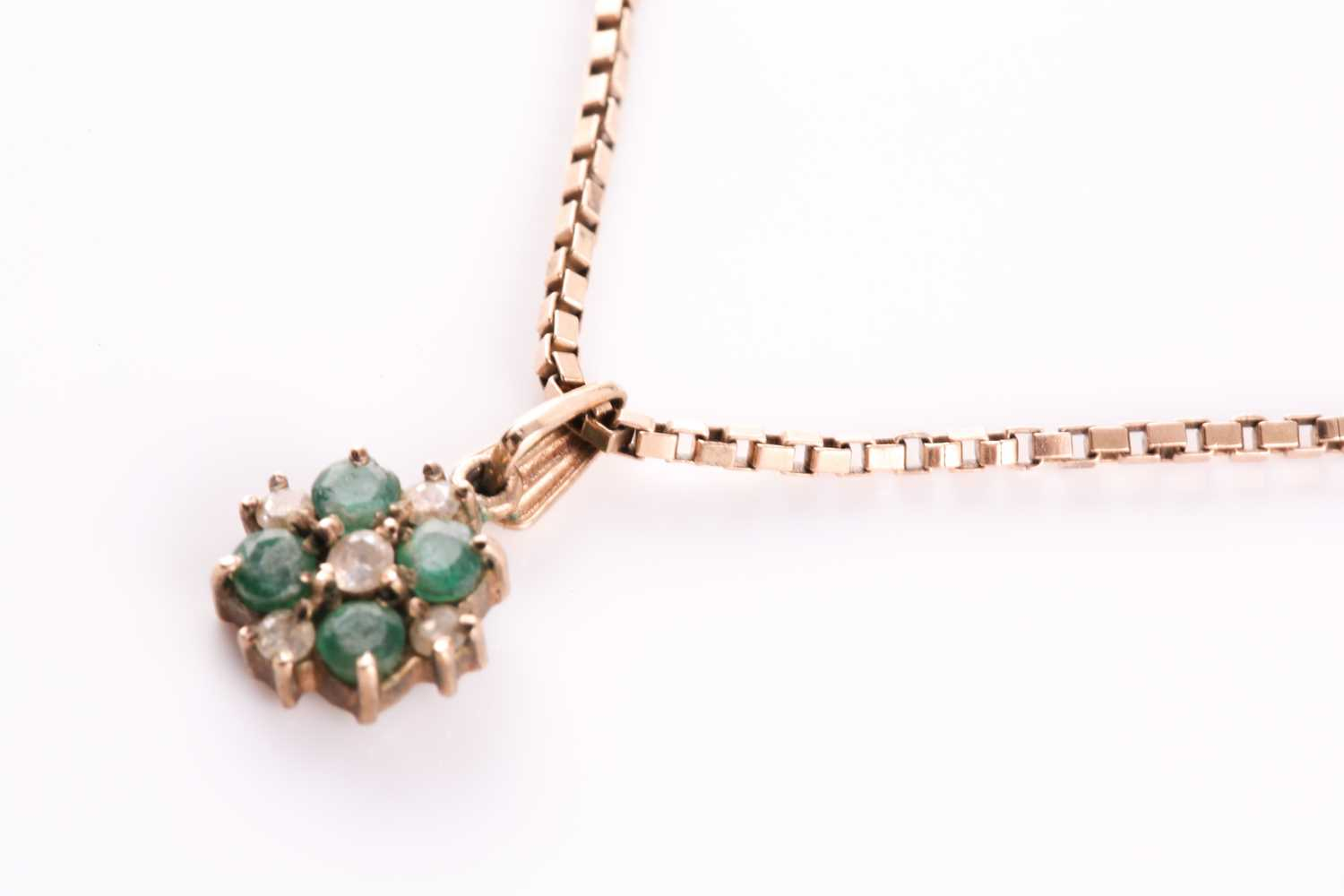 A yellow metal, emerald, and white stone quatrefoil pendant, suspended on a yellow metal box-link - Image 3 of 3