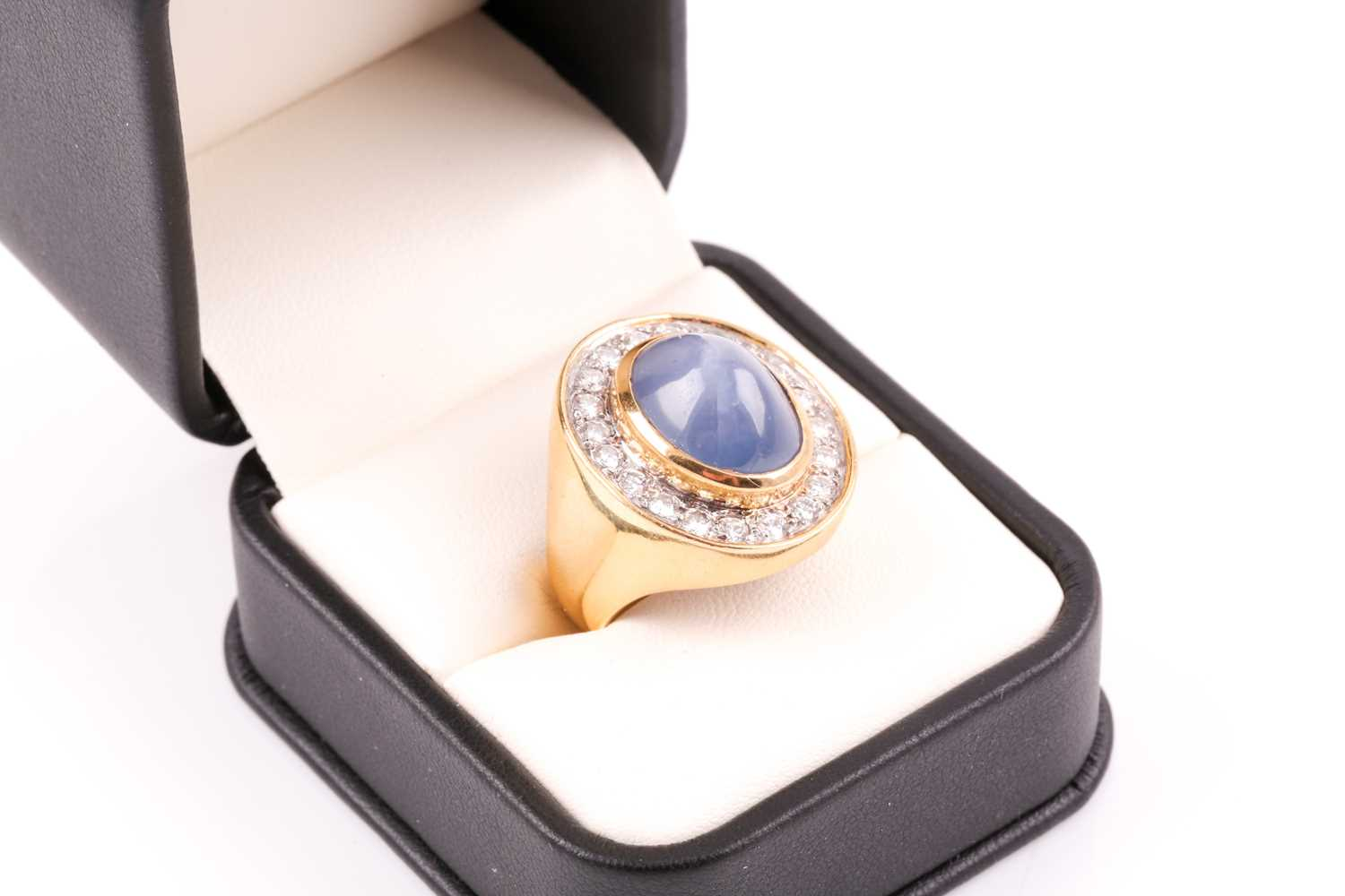 An 18ct yellow gold, diamond, and star sapphire cocktail ring, set with a domed cabochon sapphire, - Image 7 of 9