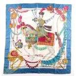 Hermes, Paris. A silk scarf depicting Italian theatrical figures including Colombine, Crispin, and