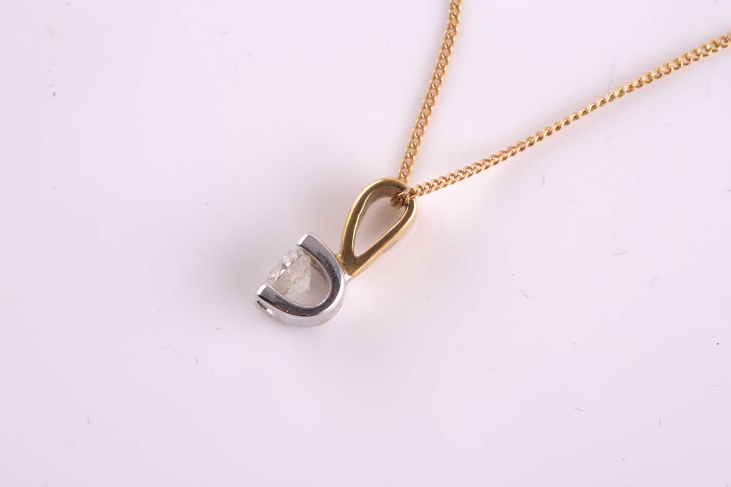 An 18ct yellow gold and solitaire diamond pendant, set with a round brilliant-cut stone of - Image 3 of 5